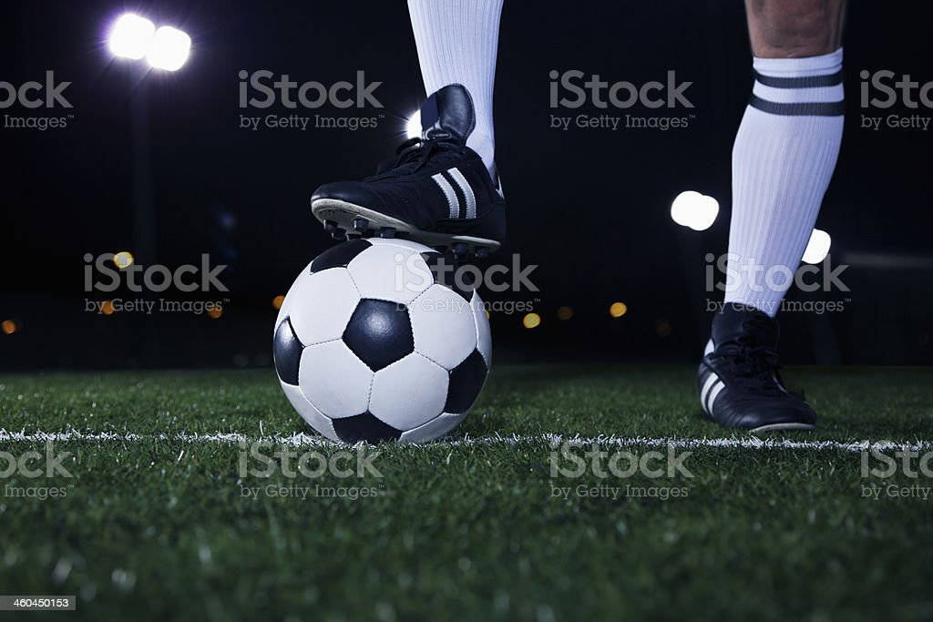 Feet on top of soccer ball stock photo
