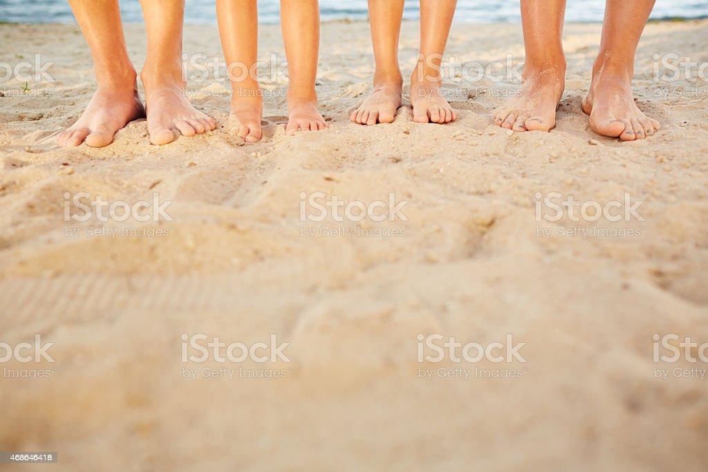 Feet on warm sand stock photo