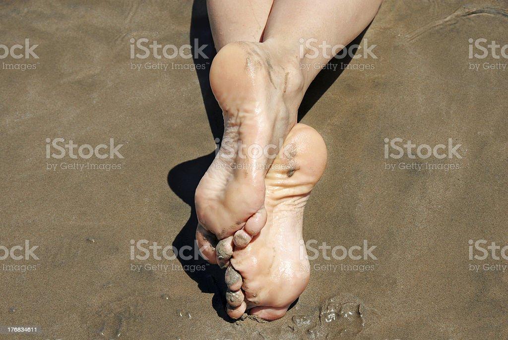 Feet on wet sand royalty-free stock photo