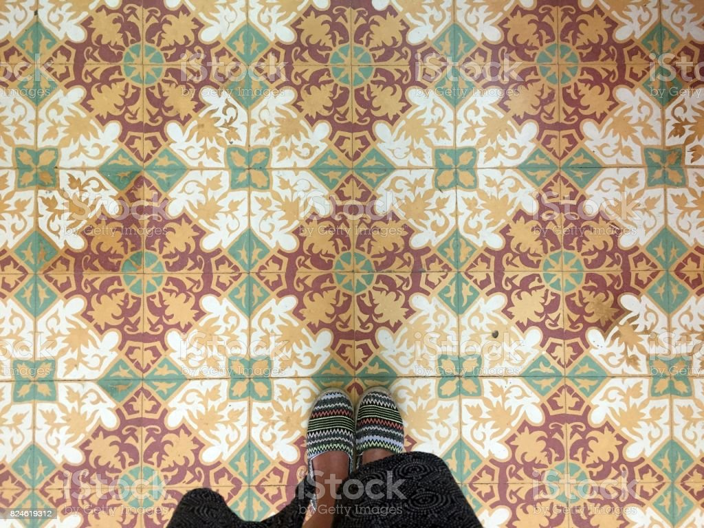 Feet over vintage tiled floor stock photo