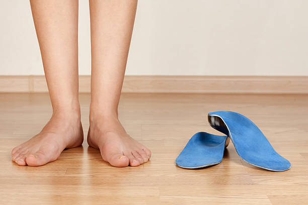 feet the girl's legs and orthotics inserting stock pictures, royalty-free photos & images
