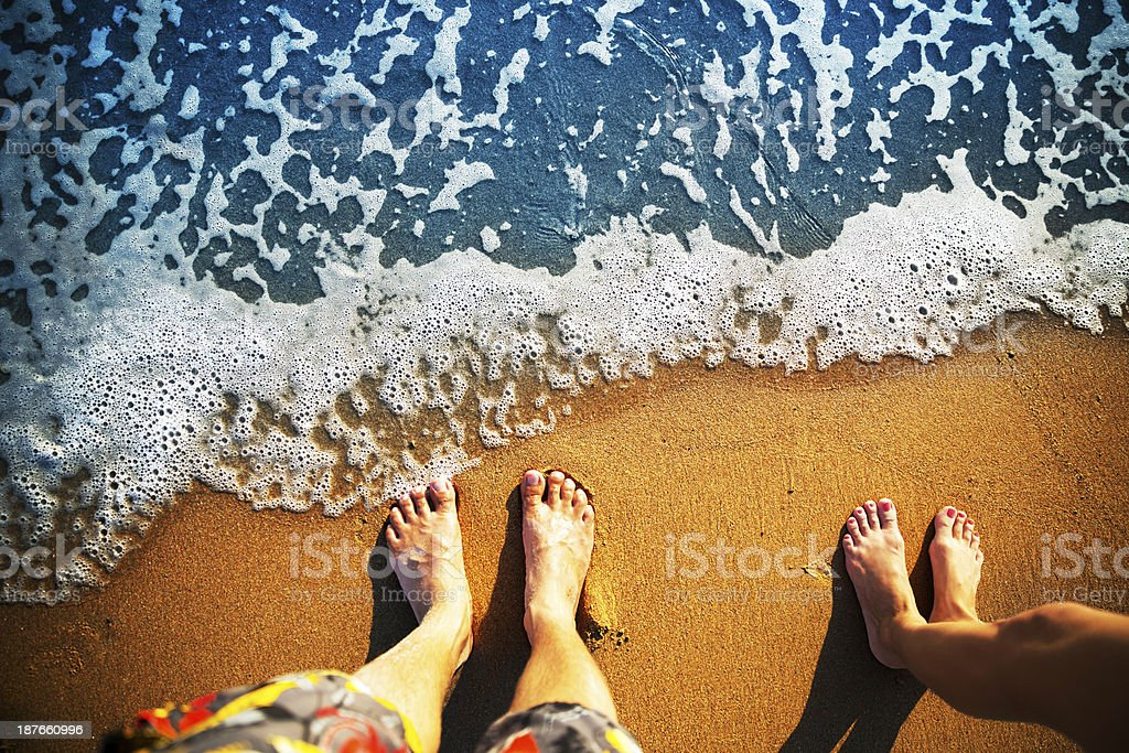 Feet standing on the beach stock photo