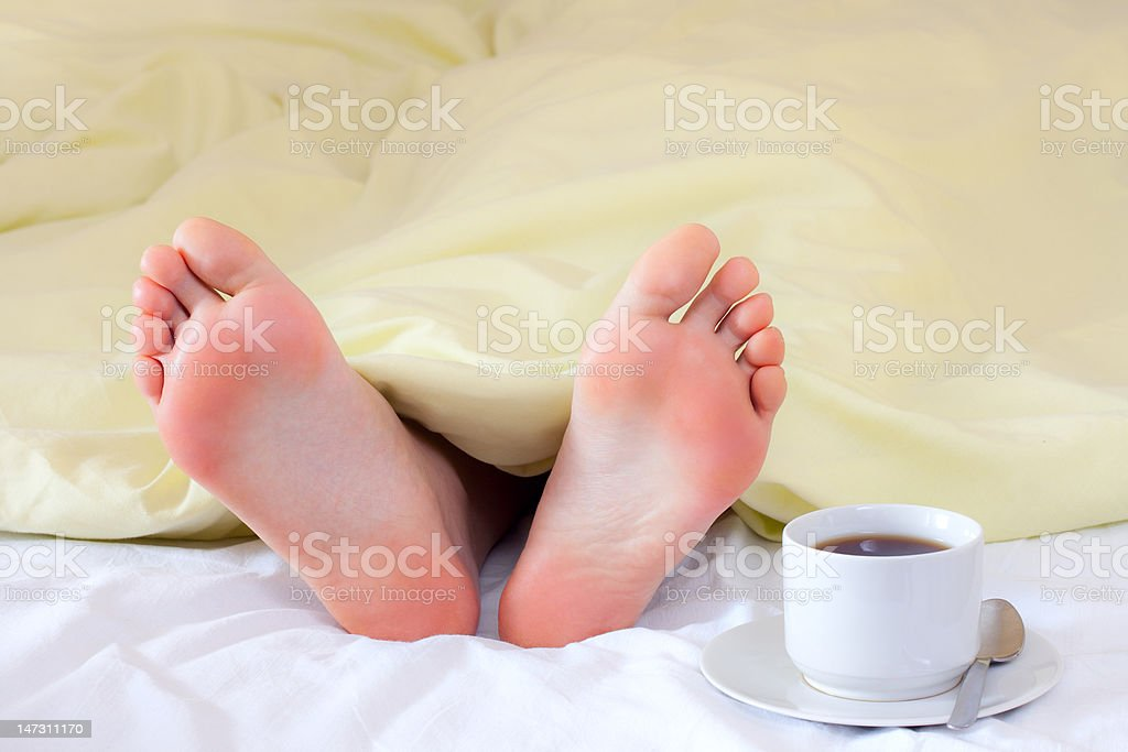 feet under blanket royalty-free stock photo