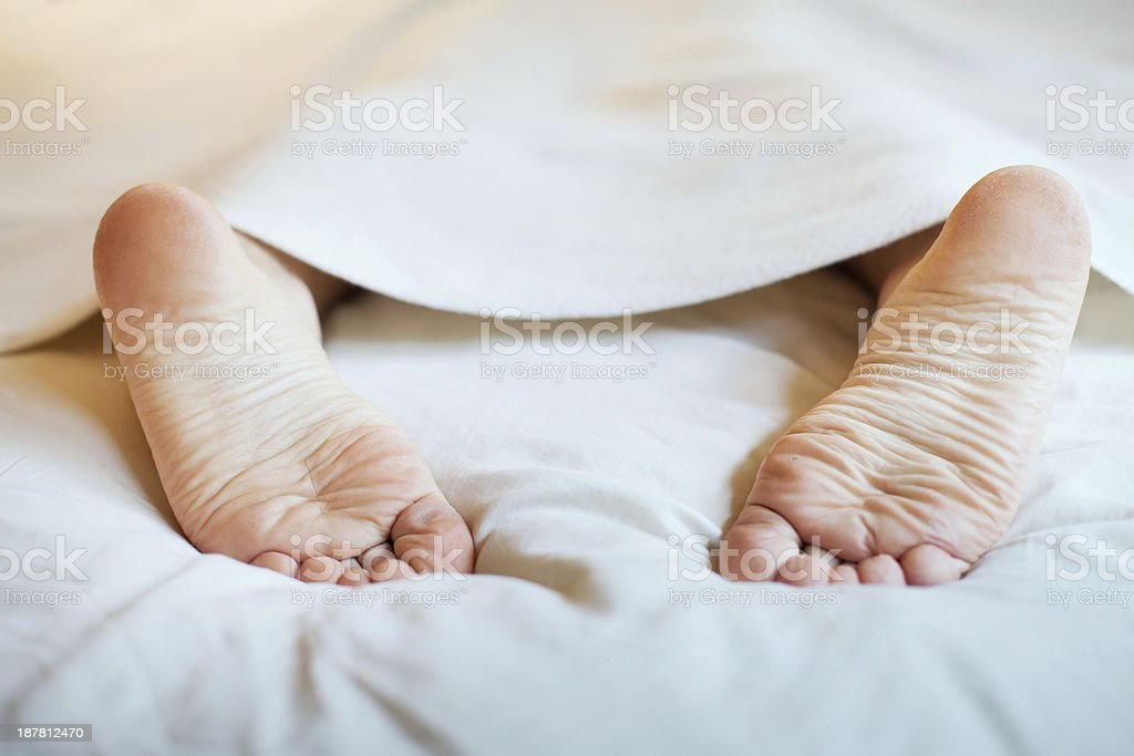 feet under blanket laziness and sleep Abstract Stock Photo