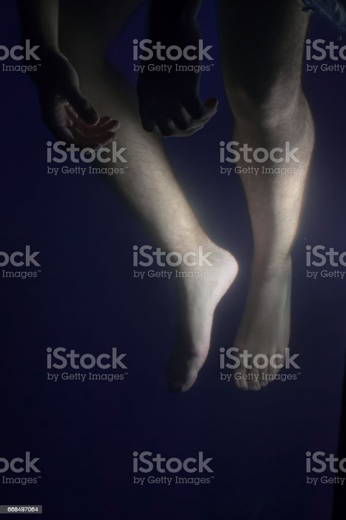 Feet under the water stock photo