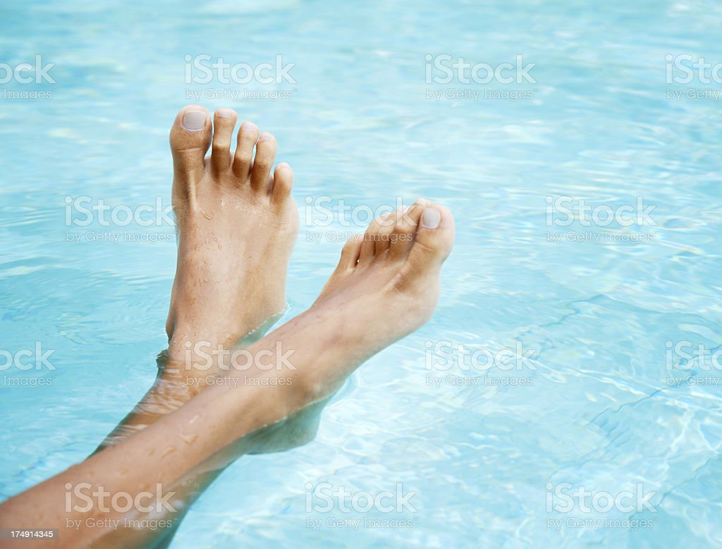 Feet up, Relaxing by the pool (XXXL) royalty-free stock photo