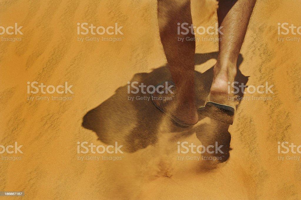 feet walk along red sand stock photo