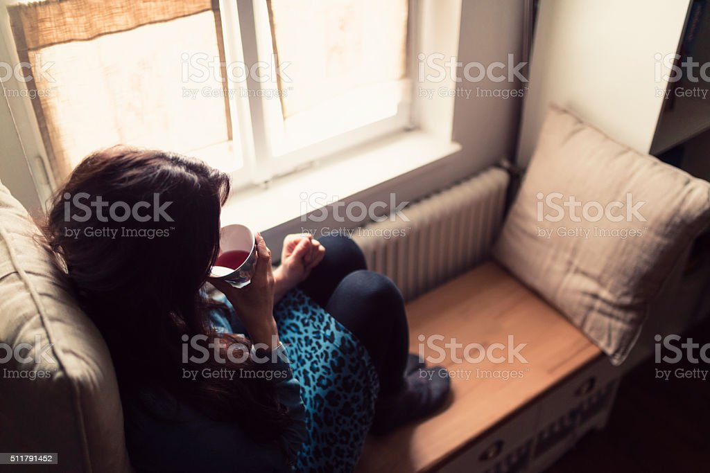 feet warming and tea time stock photo