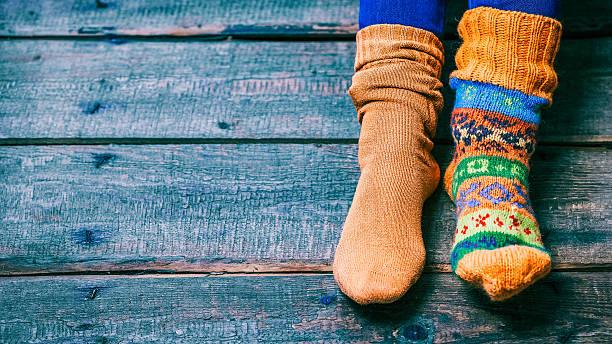 feet wearing socks - flippige outfits stock-fotos und bilder