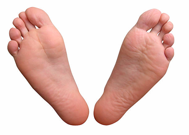 Feet with clipping path Male feet with clipping path. sole of foot stock pictures, royalty-free photos & images