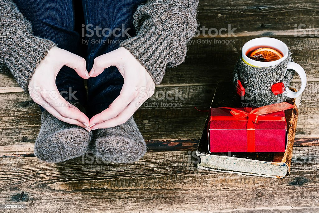 Feet with giftbox, tea and honey stock photo