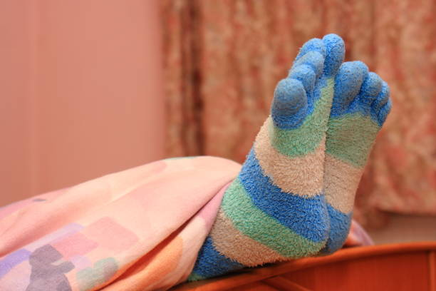 feet with striped socks - lila teenschlafzimmer stock-fotos und bilder