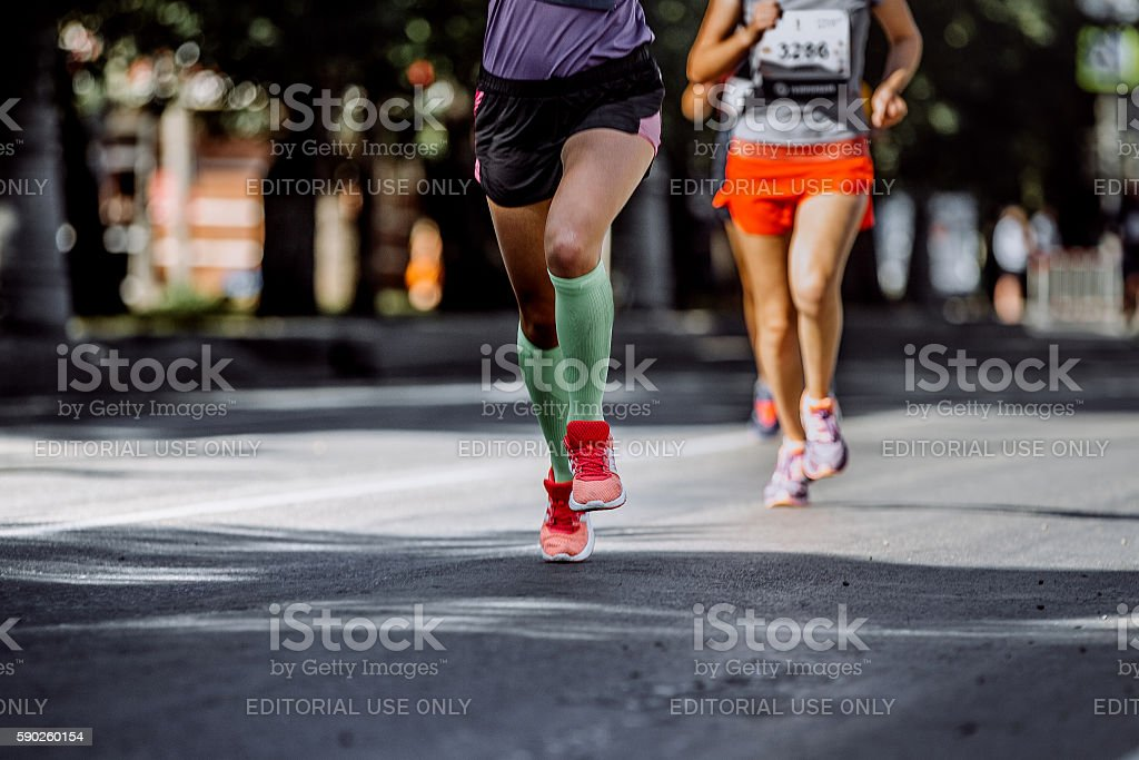 feet young woman athletes compression socks stock photo