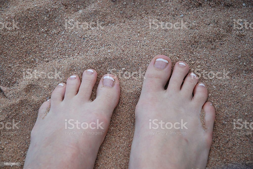feets in the sand stock photo
