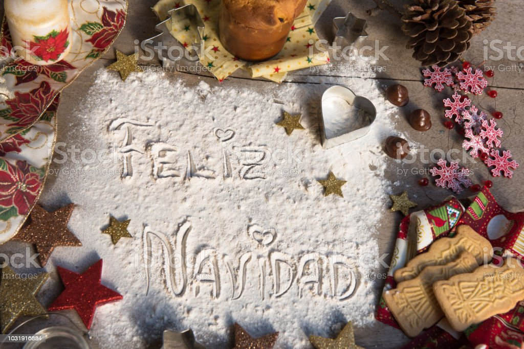 feliz navidad spanish text made with flour surrounded by christmas decorations royalty