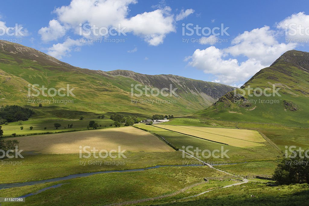 Fells by Buttermere Lake District Cumbria England uk blue sky stock photo