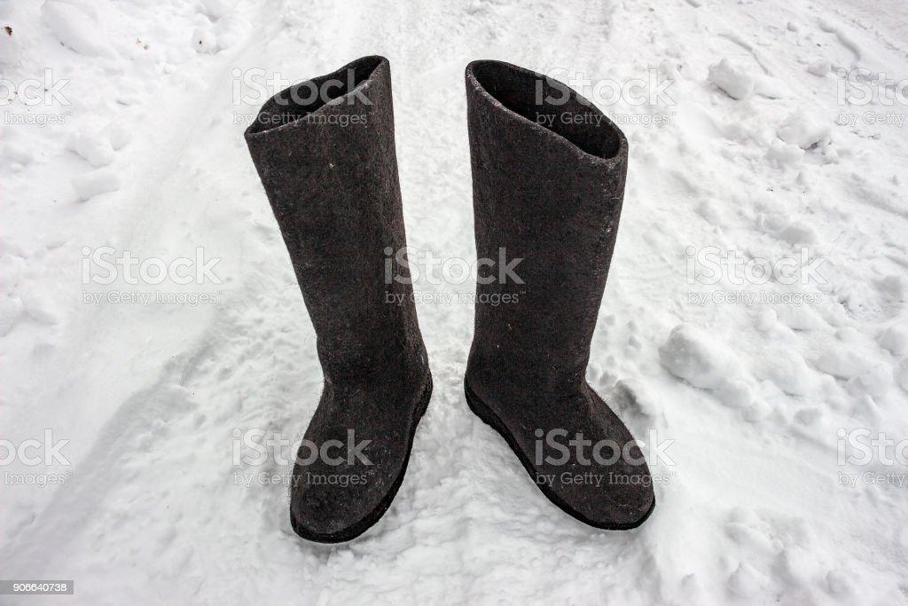Felt boots on the snow. Russian footwear - valenki stock photo