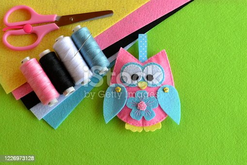 istock Felt owl embellishment. Felt owl toy. How to make a pretty felt owl - kids DIY crafts tutorial. Sheets of colored felt, scissors, thread, needle 1226973128
