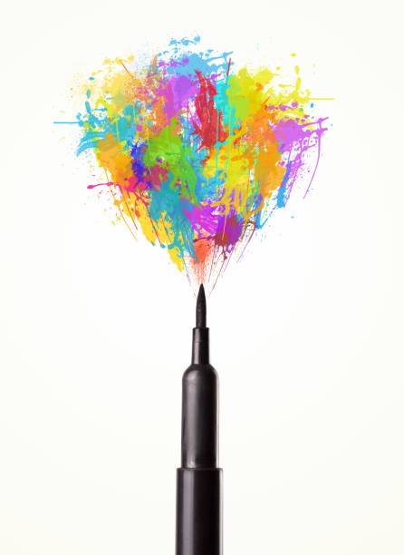 Felt pen close-up with colored paint splashes stock photo