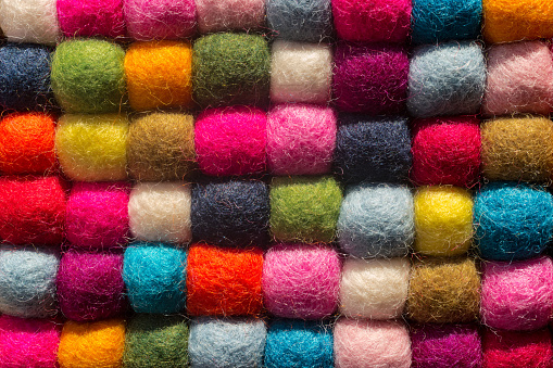 Felting background: top view of multicolored woolen balls