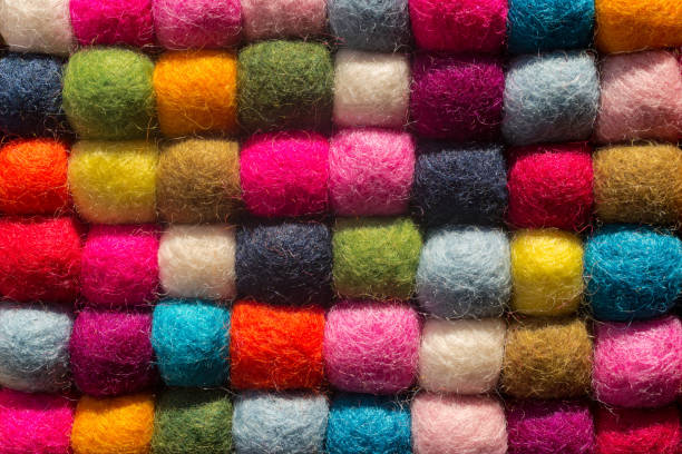 felting background: top view of multicolored woolen balls - wool stock photos and pictures