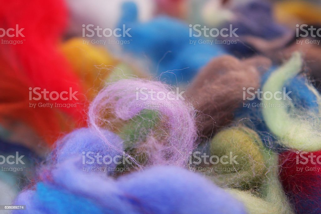 Felting materials - pieces of colored wool for felting stock photo