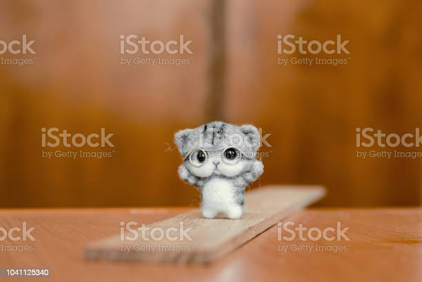 Felting toy little gray kitten in glasses on wooden stand picture id1041125340?b=1&k=6&m=1041125340&s=612x612&h=d8o2ssxfgihfwdtk9papcxee orrkurfq2ztgmlkmau=