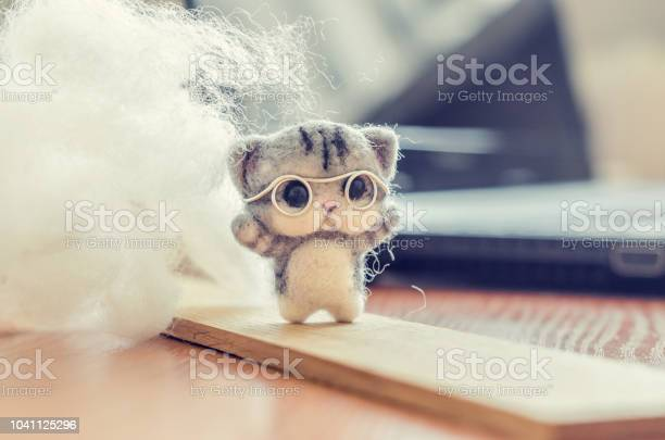 Felting toy small gray kitten in glasses on wooden stand wool on picture id1041125296?b=1&k=6&m=1041125296&s=612x612&h= hemvsfxcfkvy85py5yuxmjpxurpr8jbcekpyn4oaxg=