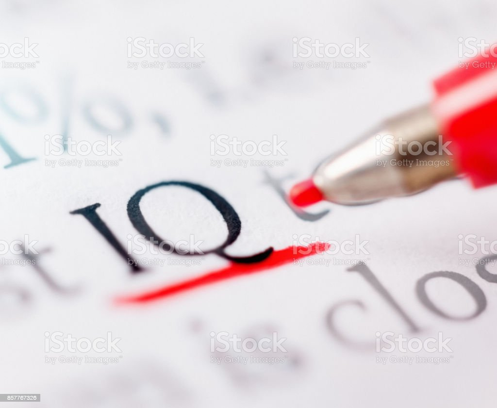 Felt-tip pen underlines word 'IQ' in document stock photo