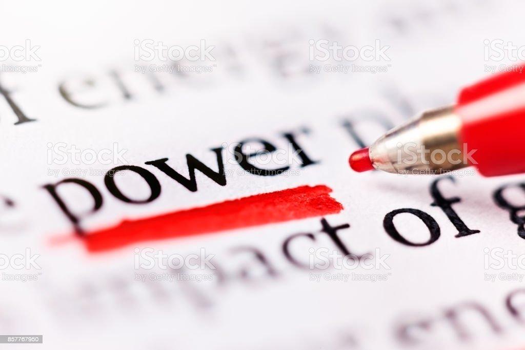 Felt-tip pen underlines word 'power' in document stock photo
