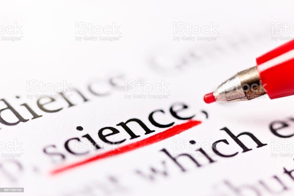Felt-tip pen underlines word 'science' in document stock photo