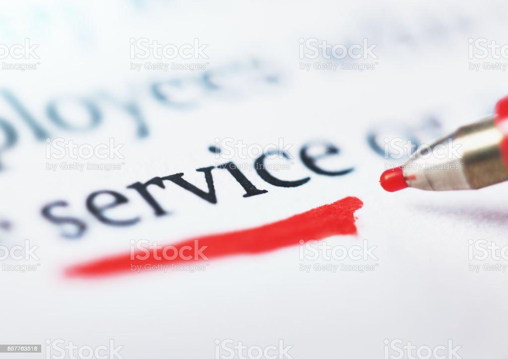 Felt-tip pen underlines word 'service' in document stock photo