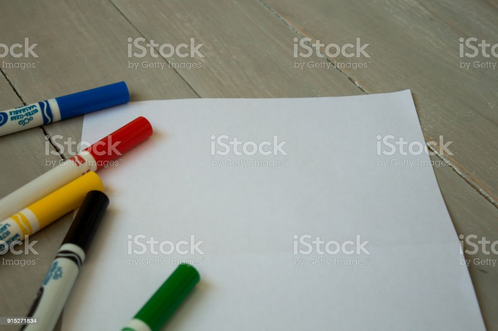 felt-tippers on a grey wooden bacground stock photo