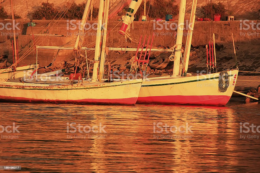 Felucca boats at sunset, Luxor royalty-free stock photo