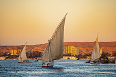 Felucca tourist boats on the river Nile at sunset in Luxor