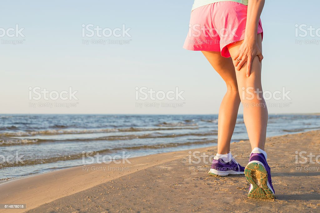 Femail runner with pulled hamstring stock photo