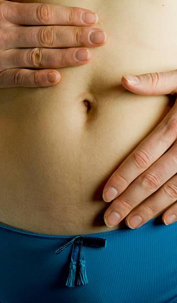 Female abdomen and navel stock photo