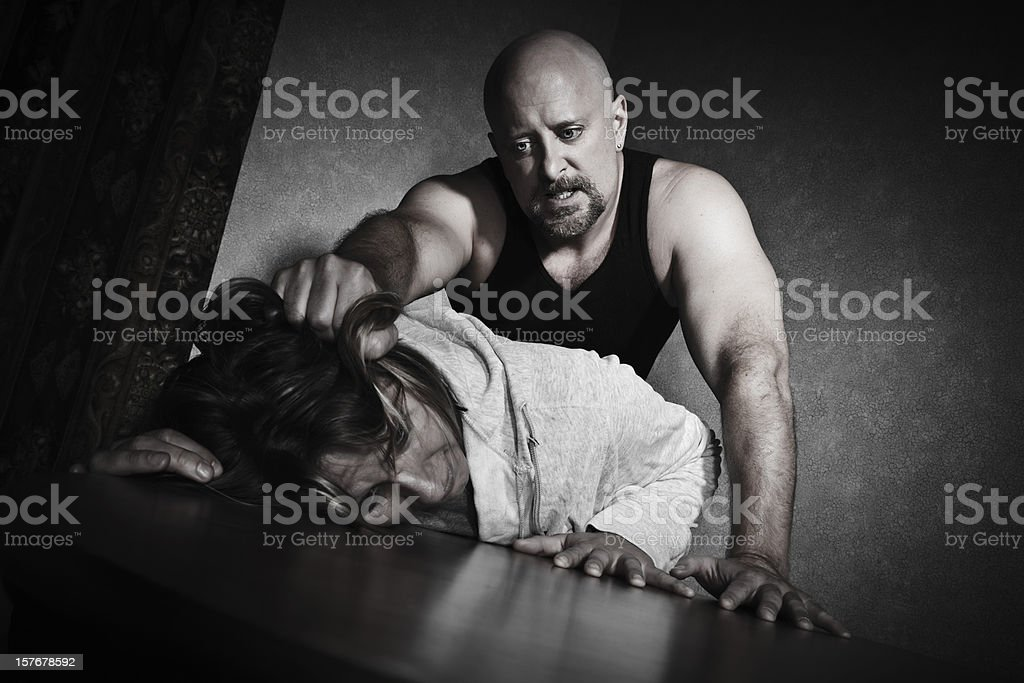 Female Abuse Victim Being Grabbed By Man royalty-free stock photo