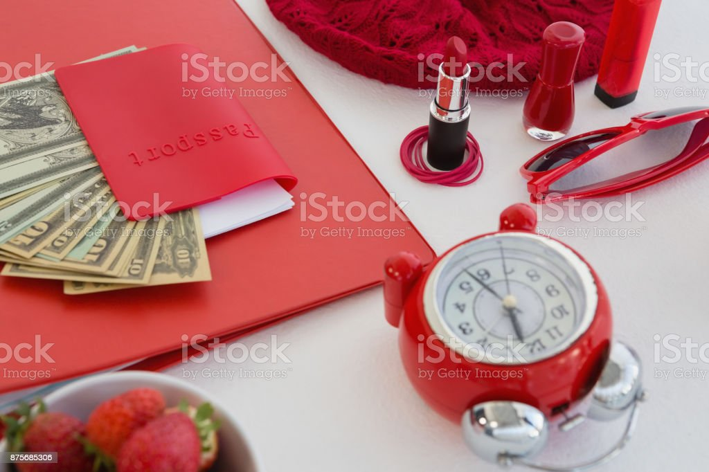 Female accessories, fruits and currency on white background stock photo
