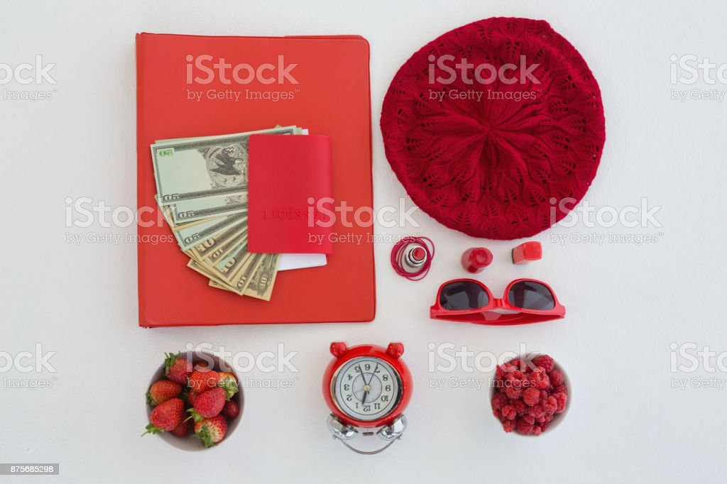 Female accessories, fruits, currency and bunch of flower on white background stock photo