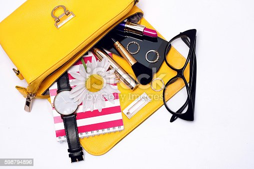 istock Female accessories in bag . Top view 598794896