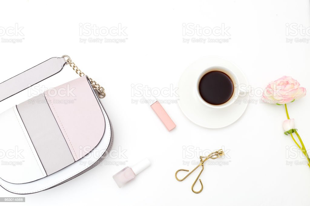 Female accessories, make up on a white background. Coffee break stock photo