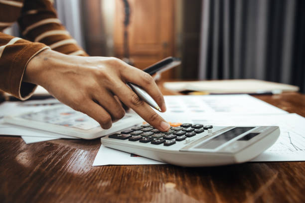 Female accountant or banker making calculation of finance and economy banking concept. stock photo