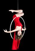 Female aerial dancer in red dress