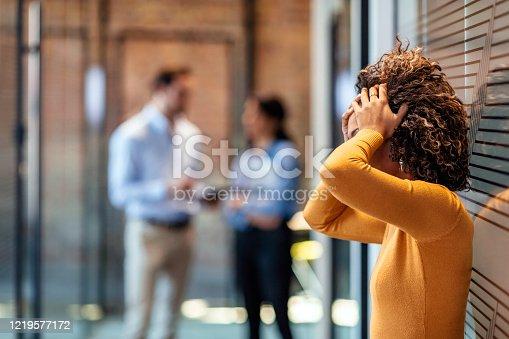 Stressed employee intern suffering from gender discrimination or unfair criticism.