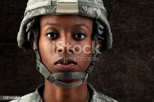 istock Female African American Soldier Series: Against Dark Brown Background 125144484