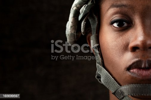 istock Female African American Soldier Series: Against Dark Brown Background 165699597