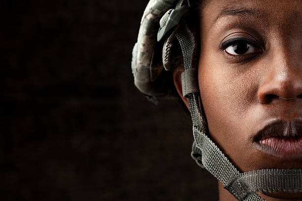 female african american soldier series: against dark brown background - warrior person stock pictures, royalty-free photos & images