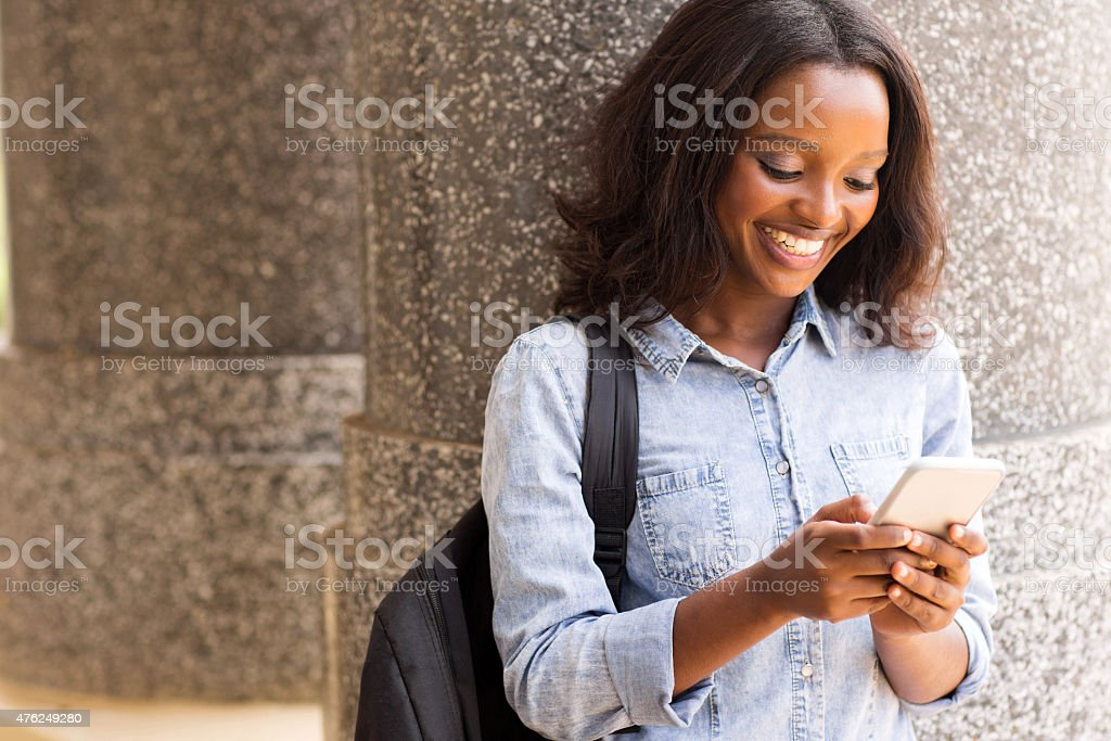 female afro american university student using cell phone stock photo