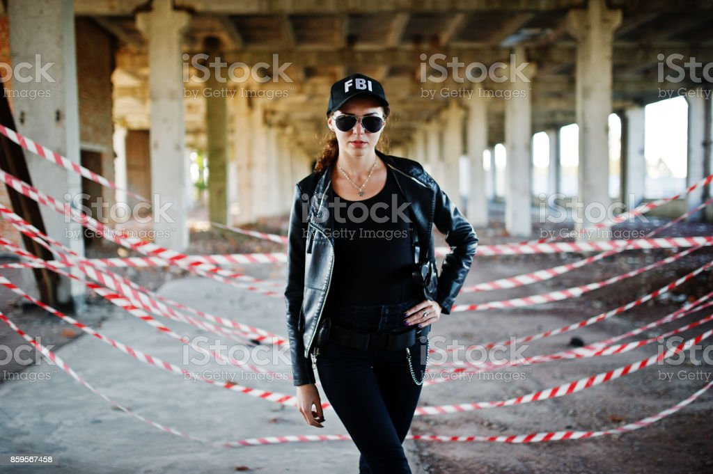 Fbi Female Agent At Abandoned Place Stock Photo